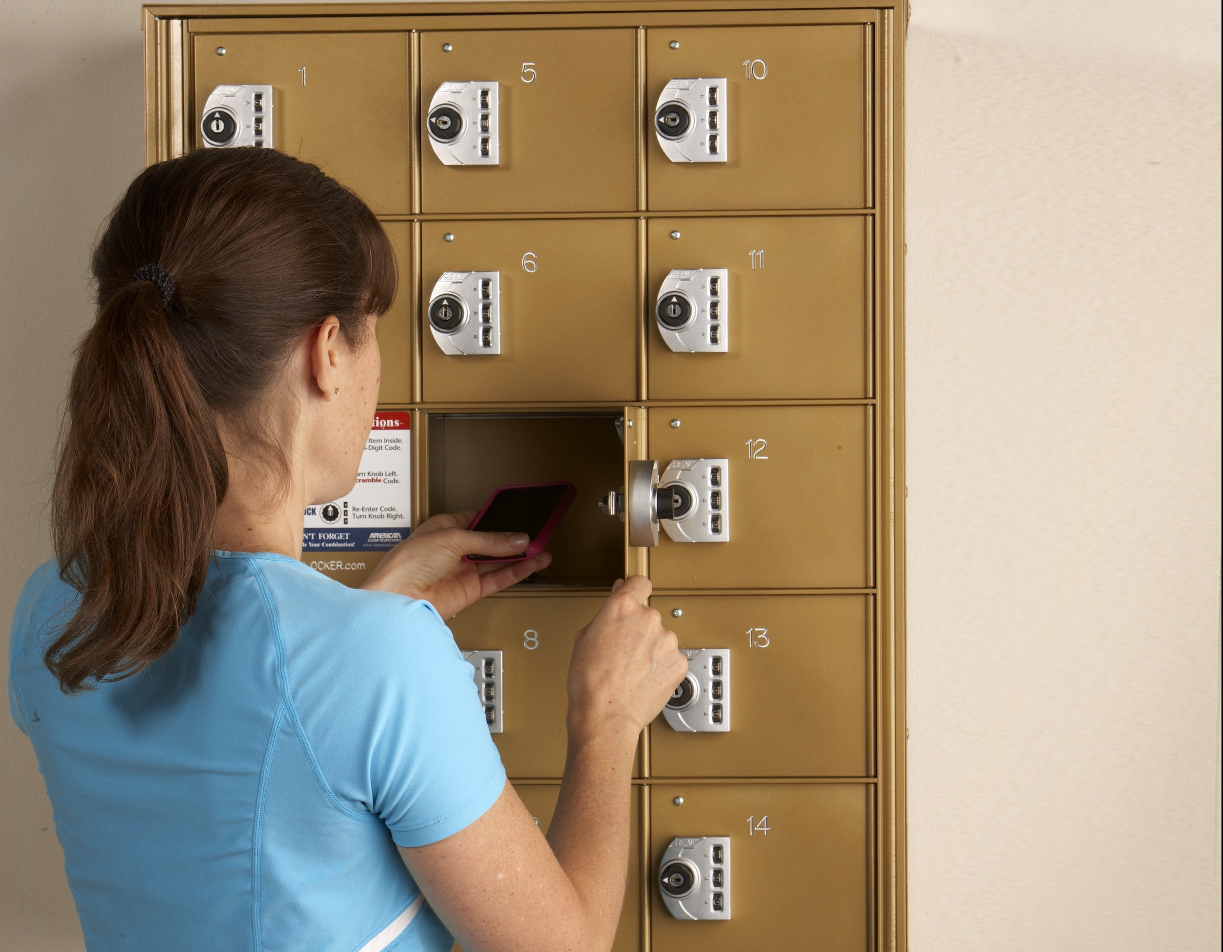 Woman opening a mini-check mirco front-load locker